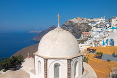 Church in Fira with Imerovigli in the back Stock Image