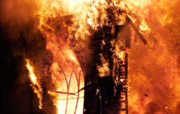 Church Fire. Flames engulfing an old church Stock Photography