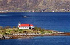 Church in fjord on Lofoten islands in Norway Stock Images