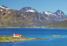 Church in fjord on Lofoten islands in Norway Stock Image