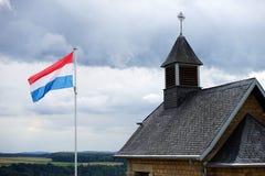 Church and flag Stock Photos