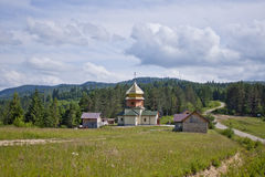 Church in the forest. Against the sky Stock Photo