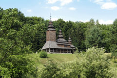 Church in the forest. Old wooden church on the edge of the forest Royalty Free Stock Images