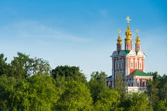 Church in forest in sunshine. Classic Orthodox church in the forest in sunshine Stock Photo