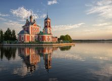 Church of Forty Martyrs. Pereslavl-Zalessky, Russia. Church of the Forty Martyrs of Sebaste reflected in water of Lake Pleshcheyevo at sunset, Pereslavl-Zalessky stock photo