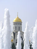 Church through fountain. Orthodox church and fountain in park of Victory, Moscow royalty free stock photography