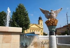 Church and fountain. Reformed church and fountain in Debrecen city, Hungary Royalty Free Stock Photos