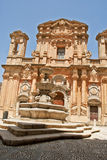 Church and fountain. Baroque church and fountain in marsala Royalty Free Stock Photo