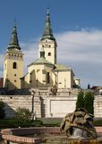 Church and fountain in Zilina. Church and fountain on the main square of Zilina town in Slovakia Stock Photo