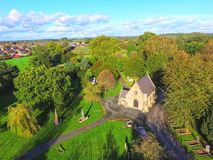 Free Church From Above With Green Fields And Blue Skies Drone Imagery Stock Photo - 161340520