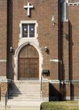 Church Front. The front of a beautiful church with ornate markings around the doors Stock Photo