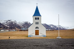 A church in front of mountains in Iceland. Beautiful scenery in Iceland, with a church in the foreground and mountains in the background Royalty Free Stock Images