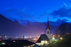 Church in front of mountains at night stock photo