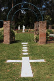 Church garden with cross and Virgin Mary Royalty Free Stock Photos