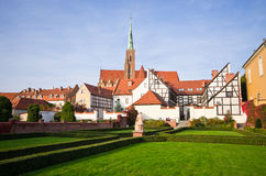 Church and garden on Ostrow Tumski, Wroclaw, Poland Royalty Free Stock Image