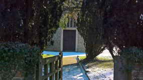 Church Gate Entrance In Surrey. On a sunny day in winter. There are Ewe trees either side stock image