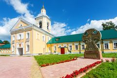 Church on the gate Iverskaya and worship cross at the Holy Spiri. T Monastery in Borovichi, Russia. Monastery was founded in 1327 Stock Photos