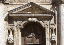 Church gate. Peculiar stone ade gate on a sunny day royalty free stock image
