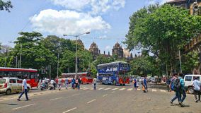 Church gate station in mumbai city india with bus and people crossing stock image