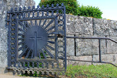 Church Gate of Wrought Iron with a Cross. Old church gate of wrought iron with a cross stock photos