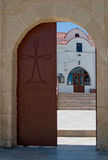 Church gateway. The door to the ancient greek church stock images