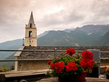 The church and the geranium royalty free stock image