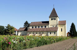 Church in Germany with wildflower meadow in front Stock Image