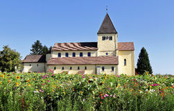 Church in Germany with wildflower meadow in front Royalty Free Stock Photography