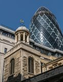 Church And The Gherkin. Gherkin building in financial district of London Stock Images
