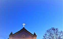 Church glowing cross royalty free stock image