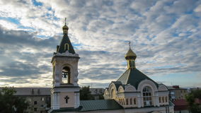 Church with Gold Domes Against the Sky and Moving Clouds. Russian Orthodox church against the sky and moving clouds. Golden domes with crosses. The old church stock video footage