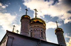 Church with golden cupola. From below shot of church with golden cupola and cross in Old Town of Kazan city Royalty Free Stock Photos