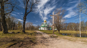 Church with golden cupola and wooden cross Royalty Free Stock Photos