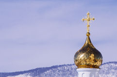 Church with golden dome. In the winter forest Royalty Free Stock Photos