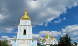 Church with golden domes and belfry, Kiev, Ukraine. Orthodox christian church with golden domes and belfry, St. Michael church in Kiev, Ukraine stock photo