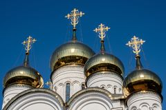Church with golden domes and crosses on blue sky background.  stock photos