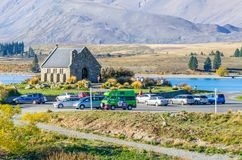 Church of the Good Shepherd which is located at Lake Tekapo. People can seen exploring around it. Stock Photo