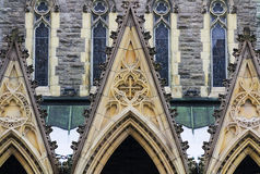 Church Gothic style entrance. Gothic church architectural details from front wall and the entrance Royalty Free Stock Images
