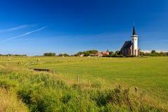 Church with grassland on a sunny day Stock Photos