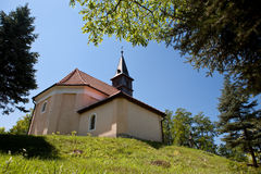 Church on a grassy hill Stock Image
