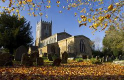 Church and Grave Yard at Badby with Autumn Leaves Royalty Free Stock Photos