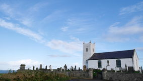 Church and Gravestones. At Ballentoy Harbour in Northern Ireland Royalty Free Stock Photo