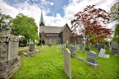 Church and Graveyard. Wide shot of historic church and graveyard Stock Image
