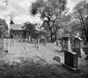 Church and Graveyard. Black and white view of old church and graveyard Royalty Free Stock Image