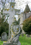 Church Graveyard with Angel. Angel statue and cross in church graveyard Stock Photography
