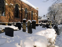 Church and graveyard in the snow Royalty Free Stock Photo