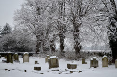 Church graveyard in the snow Stock Image