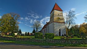 Church and graveyard in the town of Poggendorf, Mecklenburg-Vorpommern, Germany.  Royalty Free Stock Photography