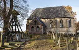 Church and Graveyard in Wanneperveen. Wanneperveen, The Netherlands - November 24, 2016: Church in Wanneperveen with the graveyard and the `Klokkenstoel royalty free stock photography