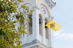 Church in Greece with a waving flag Royalty Free Stock Photo